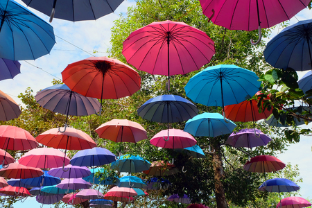 Beautiful Colorful Umbrellas in the Sky Clouds on the Street Background Great for Any Use.