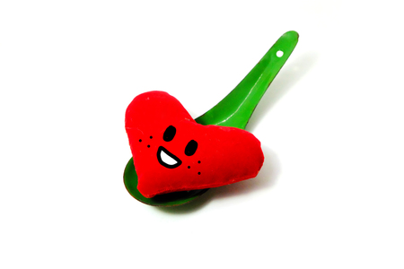 Red Heart for Valentines Day. Green Zinc Spoon with Smile and Red Heart Isolated on White Background Great for Any Use.