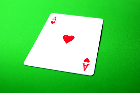 Ace Playing Card Game Isolated On Green Background Great for Any Use. Stock Photo