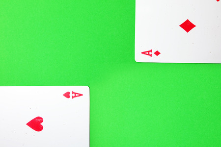 Two of Spades and Diamonds Playing card. Ace Playing cards isolated On Green Background Great for Any Use. Stock Photo