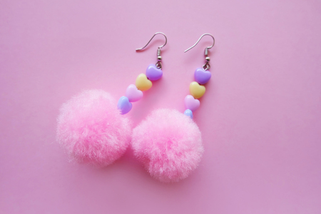 Fur Pink Round Earring Fashion Accessories. Beautiful Pink Pom Heart Earring Isolated on Pink Background Great For Any Use.
