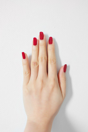 Beautiful Woman Red Nail. Female Hand with Red Nails Manicure Isolated On White Wall Background Great for Any Use.