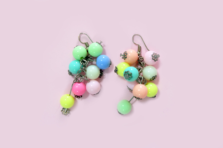 Hoop Earring Fashion Accessories. Colorful Round Earrings Isolated on Pink Pastel Background Great for Any Use.