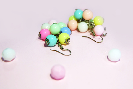 Hoop Earring Fashion Accessories. Colorful Round Earrings Isolated on Pink Pastel with Bead Background Great for Any Use. Stock Photo