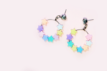 Star Hoop Earring Fashion Accessories. Hoop Earrings with Colorful Star Bead Isolated on Pink Pastel Background Great for Any Use.