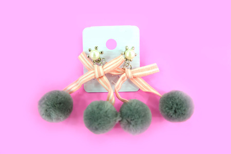 Chandelier Earring Fashion Accessories. Pair of Fur Round with Pearl Earrings Isolated for Love Romance on the Pink Background Great For Any Use.