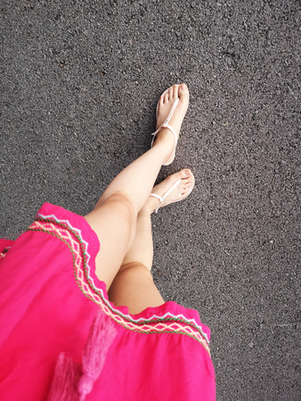 Top View Selfie of Nude Sandals on Gray Concrete. Copy Space, Beautiful Woman Wearing Pink Skirt or Dress and Shoes and Shoes Hipster on Street Background