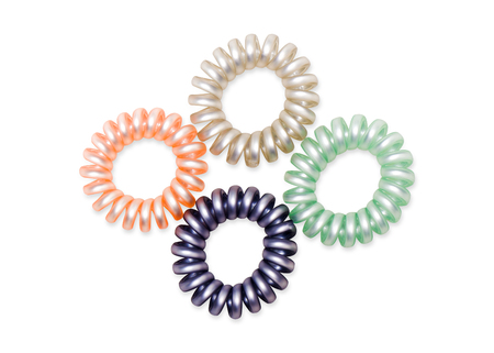 Colorful Hair Band Isolated on White Background with Clipping Path. Closeup of Spiral Four Colorful Rubber Bands for Fashion Accessories. Beautiful Elastic Hair Ties for Hairstyle, Copy Space for Text.