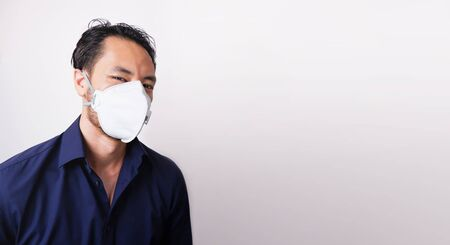 Businessman wearing protection mask on white background. Business man wear N95 mask because of pm2.5 air pollution, carbon dioxide and coronavirus fever. Conception of Healthcare. Protect body. Фото со стока - 139901155