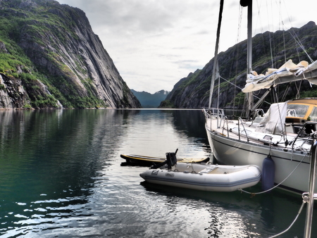 View of the fjord of the Troll in Norway. Sailing yacht.