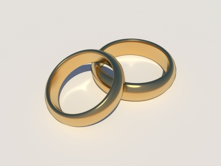 Golden wedding rings with caustic on white background Stock Photo - 22133229