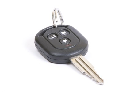 Automobile key with 3 buttons isolated on white Stock Photo - 4029730