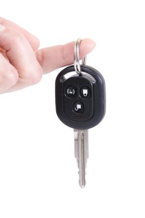 holding automobile keys isolated on white background Stock Photo
