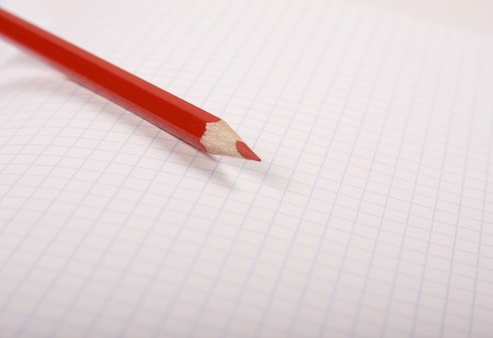Red pencil laying on the notebook Stock Photo