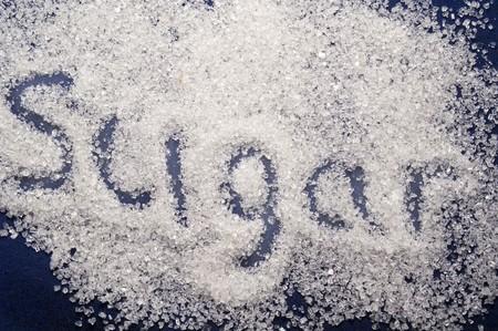 Sugar spilling on the blue background