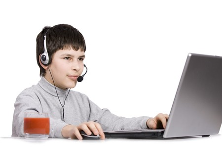 Young Boy with computer isolated on white Stock Photo - 4581906