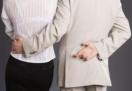 Boss hugs his subordinate in office
