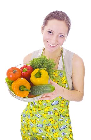 Housewife with vegetables isolated on white