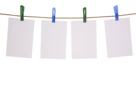 Hanging paper isolated on white background photo