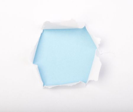 Isolated Hole in paper under the color background Stock Photo