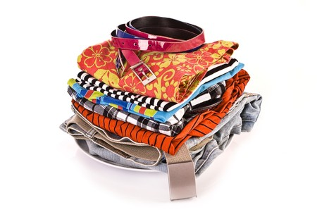 Pile of clothes isolated on white background Stock Photo