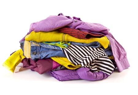 Heap of clothes on white background photo