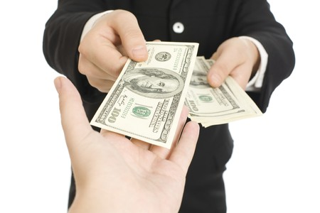 Money in human hands isolated on white background photo