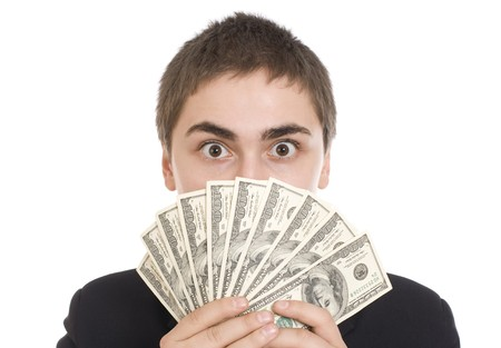 Expressive man with dollar bills isolated on white background Stock Photo