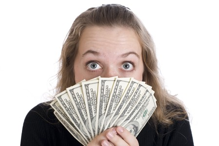 Expressive girl with dollar bills isolated on white background