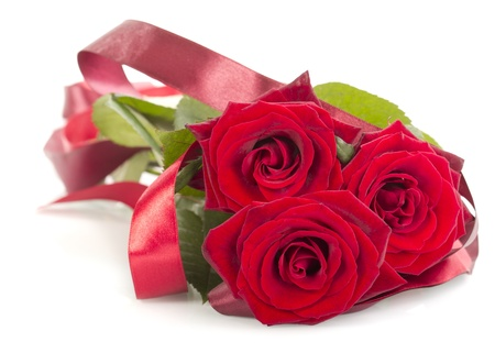 Decorated red roses isolated on white background