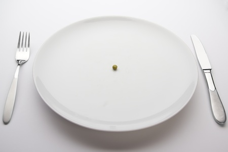 Single pea on a plate. Diet dinner photo