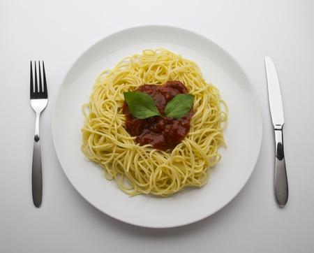 spaghetti with tomato sauce and basil photo