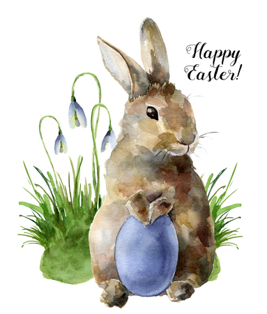 Watercolor Easter card with bunny, snowdrops and colored egg. Hand painted print with traditional symbols isolated on white background. Cute baby rabbit illustration for design.