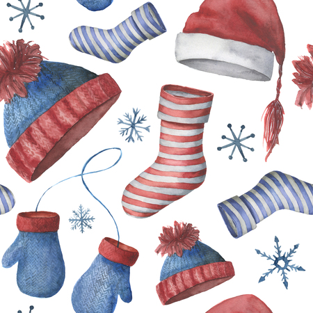 Watercolor seamless winter pattern with hats, socks and mittens.
