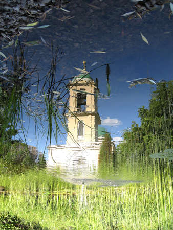 A Russian orthodox church captured in a pond reflection Banco de Imagens