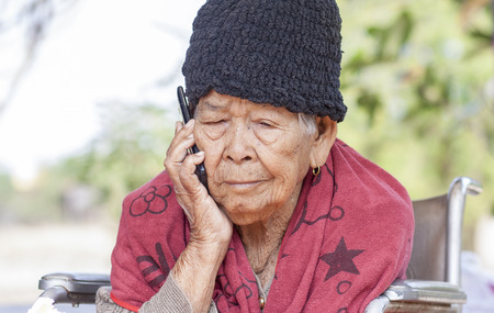 woman at the phone: old woman call phone
