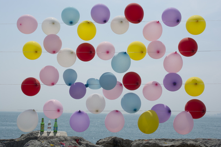 Colored balloons hanging on rope. For an air rifle shooting and blasting game