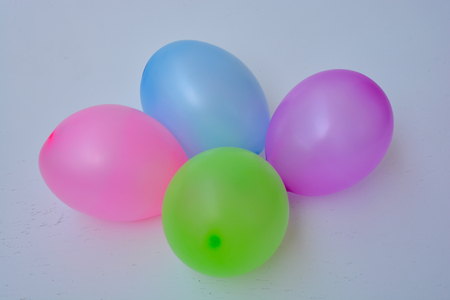 colorful, inflated balloons. ready to explode or fly