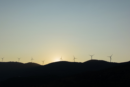 wind turbines in the mountains at sunset. wind turbines for generating electricity. mechanical power turns into electricity