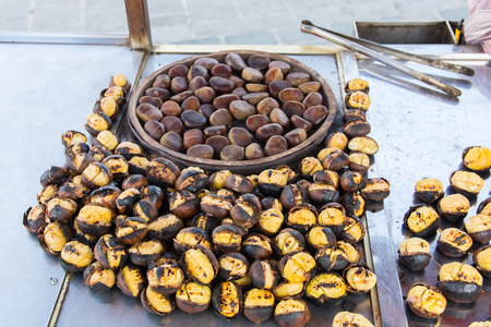Grilled chestnuts for sale on street.cooked on barbecue. plenty of Christmas and winter are consumed