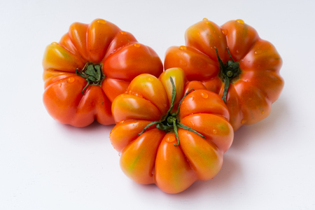 heirloom tomatoes. Fresh organic ripe tomatoes. red and green colored, sliced village tomato