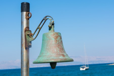 bell on the beach. summer vacation starts
