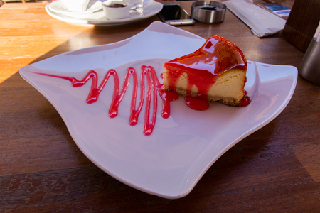 Strawberry cheesecake. a strawberry cream cake with strawberry sauce served on a nice plate