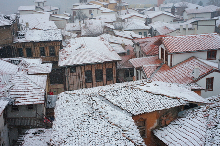 View of the city in winter. snow covered the entire city center. snowfall continues. urban buildings and city center. aerial view of the city. Ankara castle-Ankara / Turkey Фото со стока