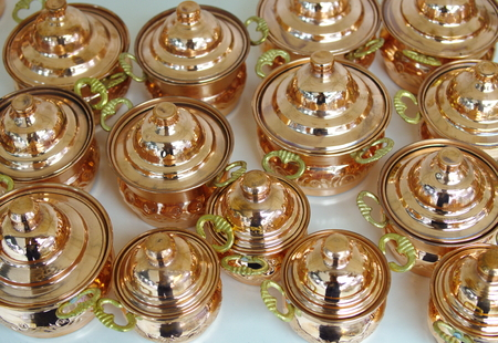 pots made of copper. polished in various sizes