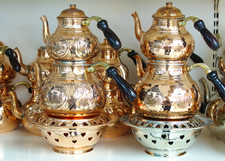 copper teapot set and samovar. under barbecue