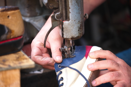 Cobbler. The master worker who repairs the shoe