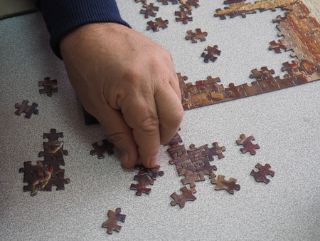 the old man who tried to combine the puzzle Stock fotó