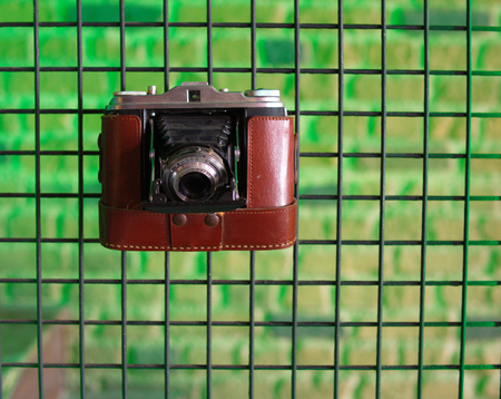 old camera hanging on the fence