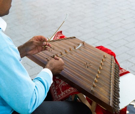 Santur is a percussion instrument of Persian  Iranic origin. played with tiny hammers